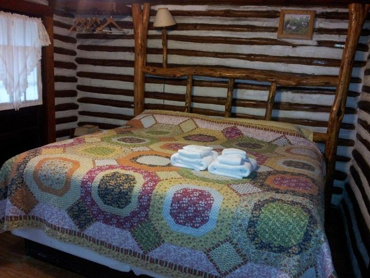 cabecero cama troncos madera