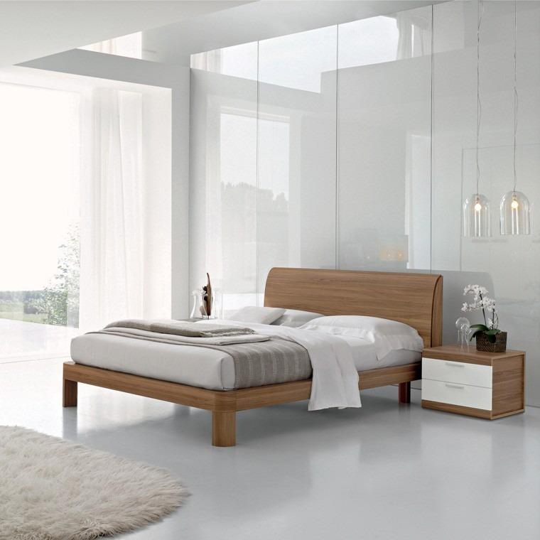 cama madera cuarto blanco