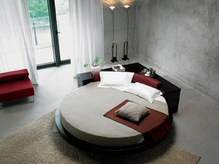 dormitorio cama redonda paredes cemento