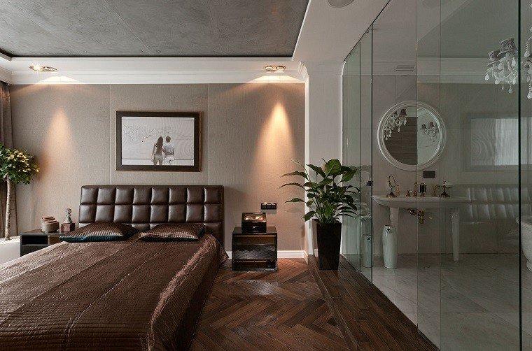 decoracion apartamentos modernos dormitorio lujo arbol cama respaldo cuero ideas