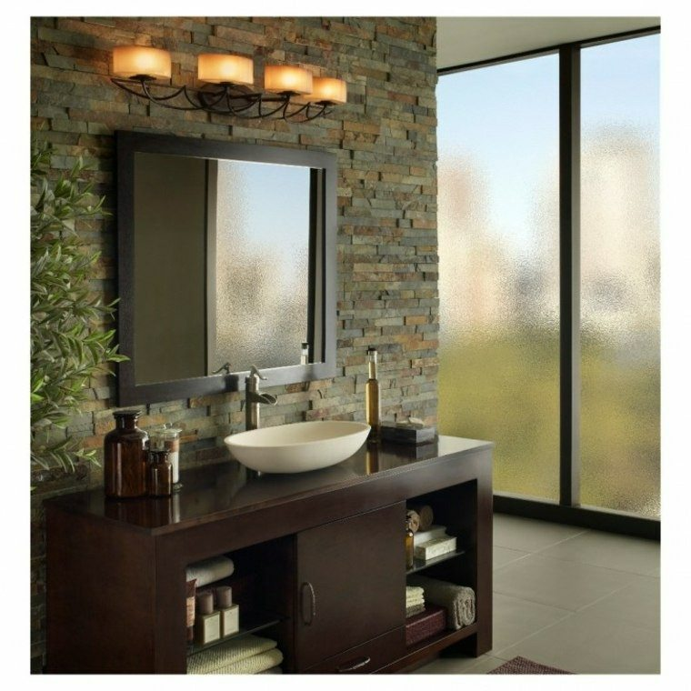 diseño cuarto baño pared ladrillo