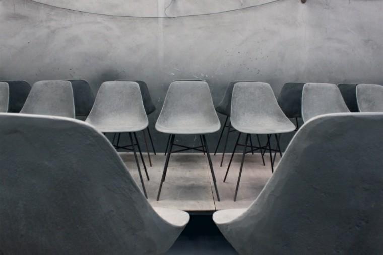diseño paredes sillas cemento grises