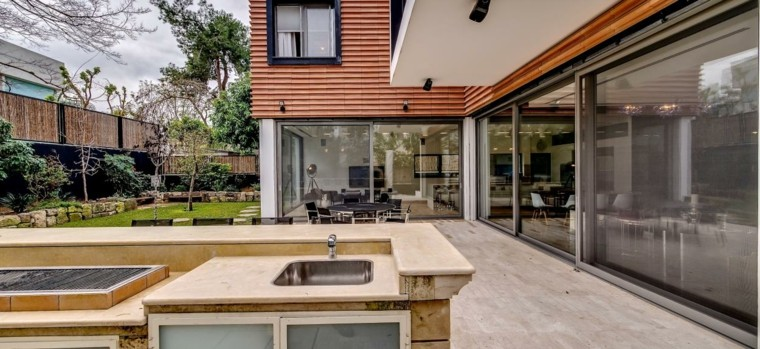 el refugio perfecto verano cocina exterior jardin cesped ideas