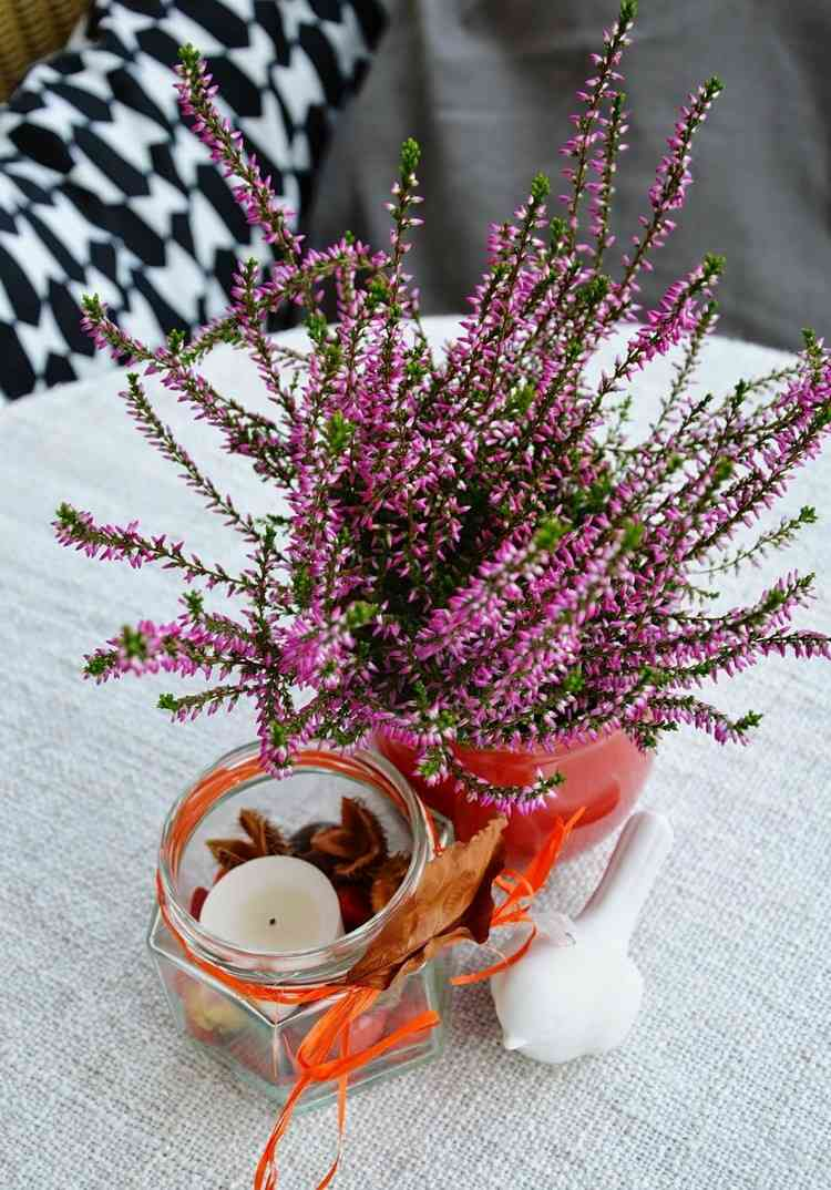 flores maceta vela blanca lazo