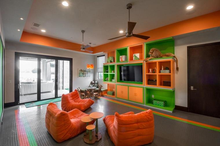habitacion juegos ninos sillones naranja televisor ideas