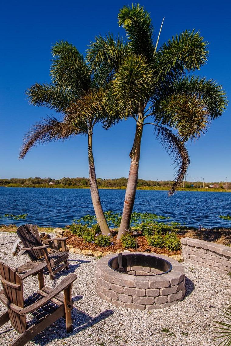 jardin suelo piedras palmeras vistas preciosas sillas teca ideas