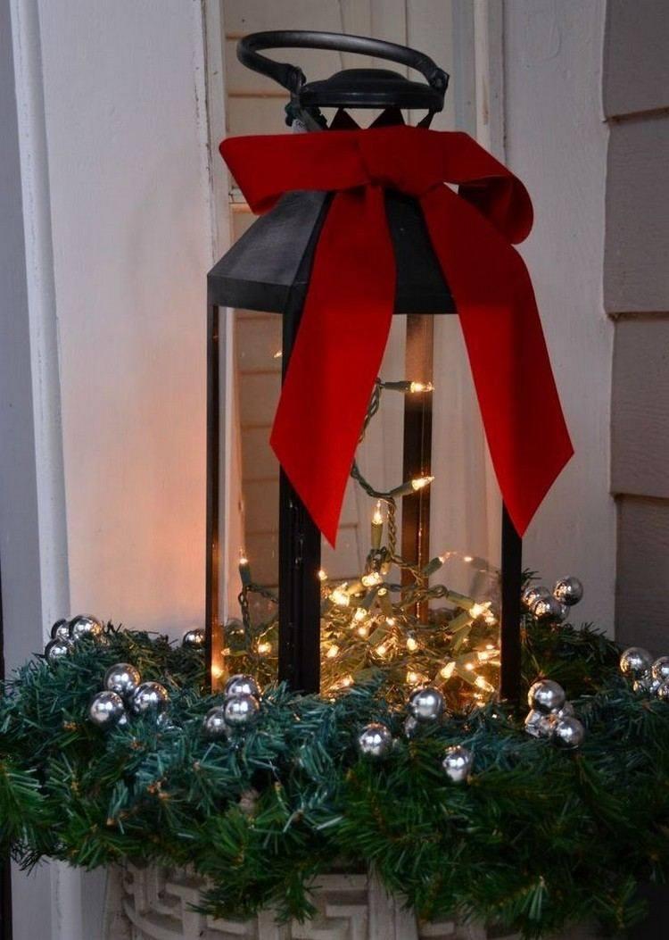 luces de navidad linterna negra lazo rojo ideas