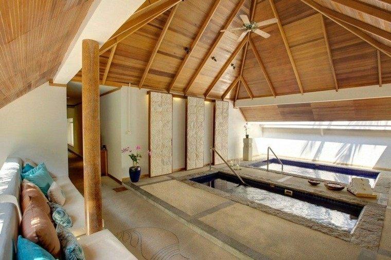 madera tropical cojnes azul sofa