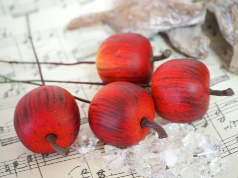 manzanas decoradas imitando calabazas