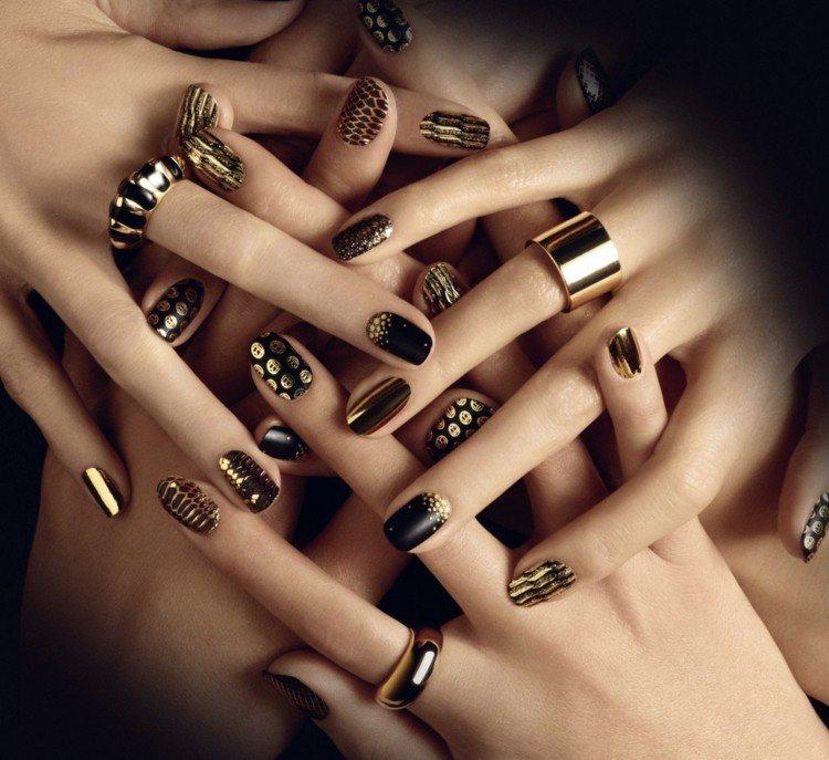 muchas uñas diseño negro dorado