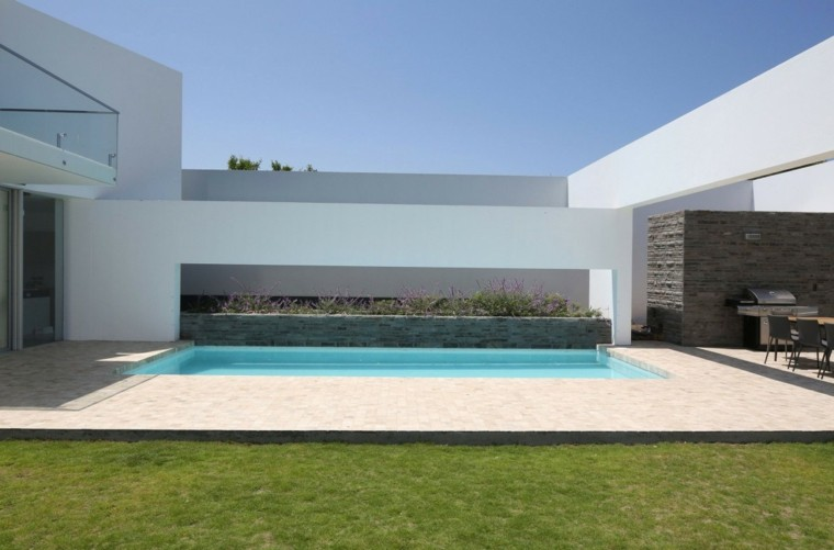 oasis moderno jardin piscina plantas maceta hormigon ideas