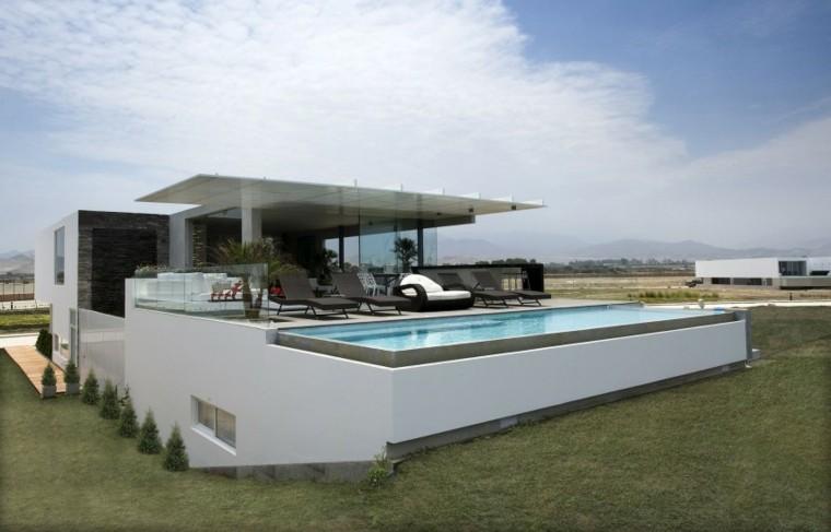 oasis moderno jardin piscina tumbonas descanso ideas