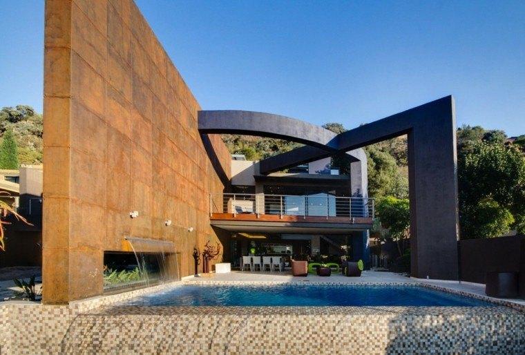 pared acero alta jardin casa moderna piscina muebles originales ideas