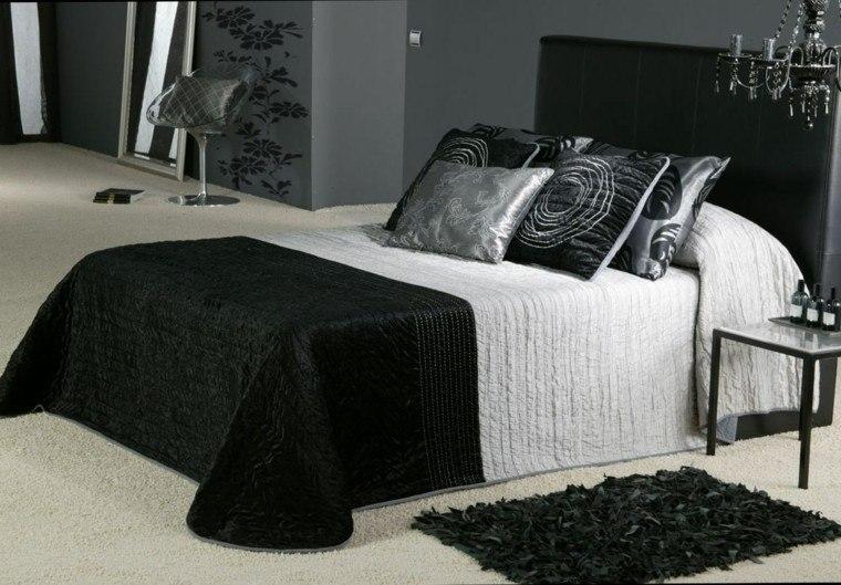 paredes grises cojines negros diseño