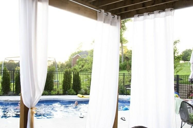 pergola white curtains pool views