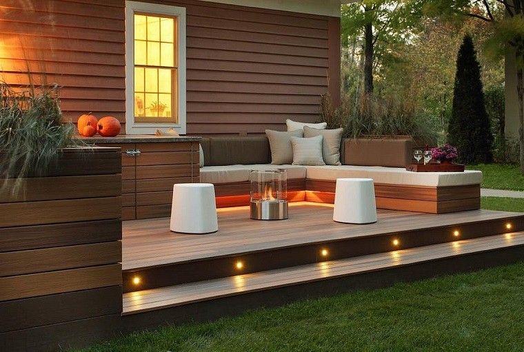 plato fuego moderno taburetes blancos terraza suelo madera ideas