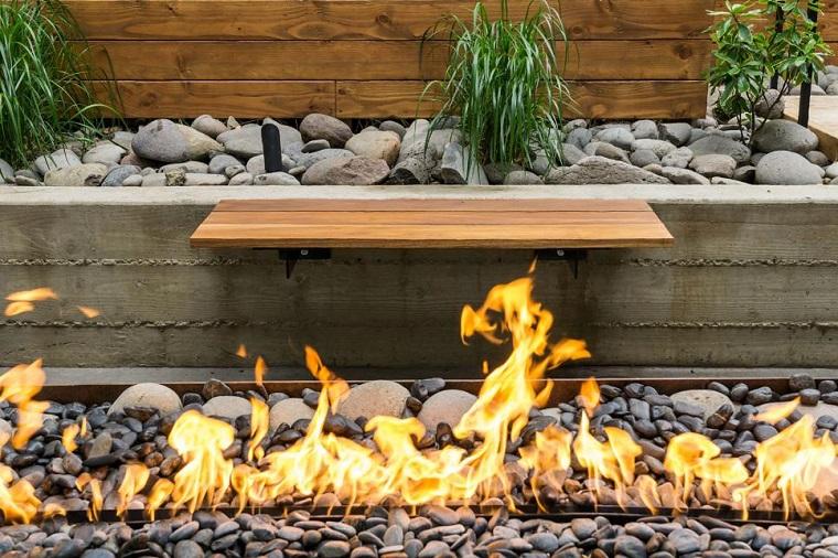 pozo fuego baldos banco madera piedras plantas ideas
