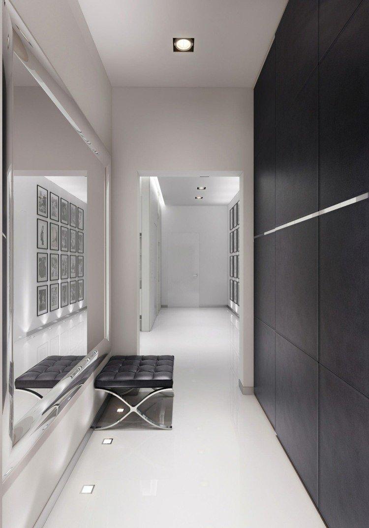 recibidor estilo minimalista pared negra