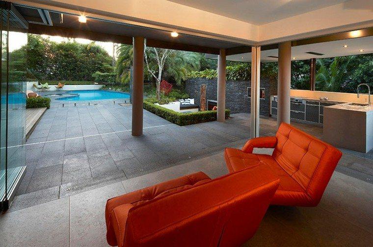 refugio perfecto verano cocina exterior sillones naranja ideas