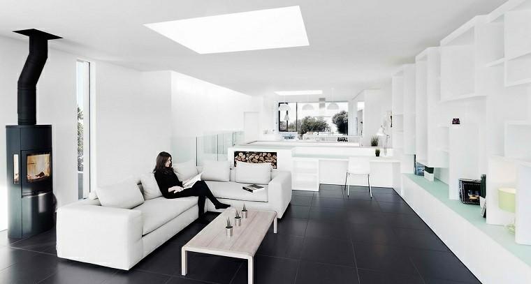 salon moderno amplio suelo losas negras chimenea sofa blanca ideas