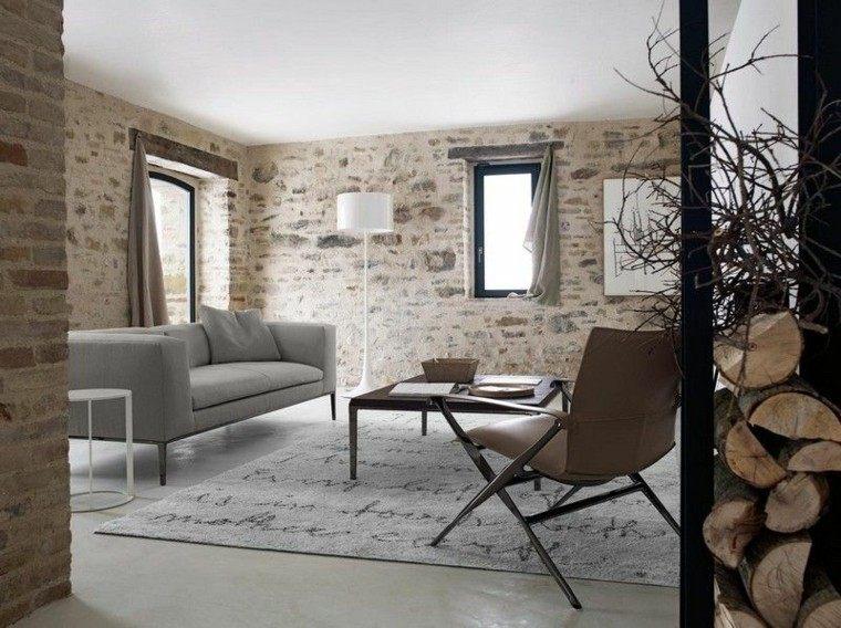 sofa diseño salon ladrillos rocas troncos