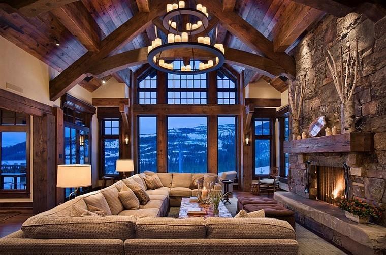 sofa grande delante chimenea lampara negra salon rustico ideas