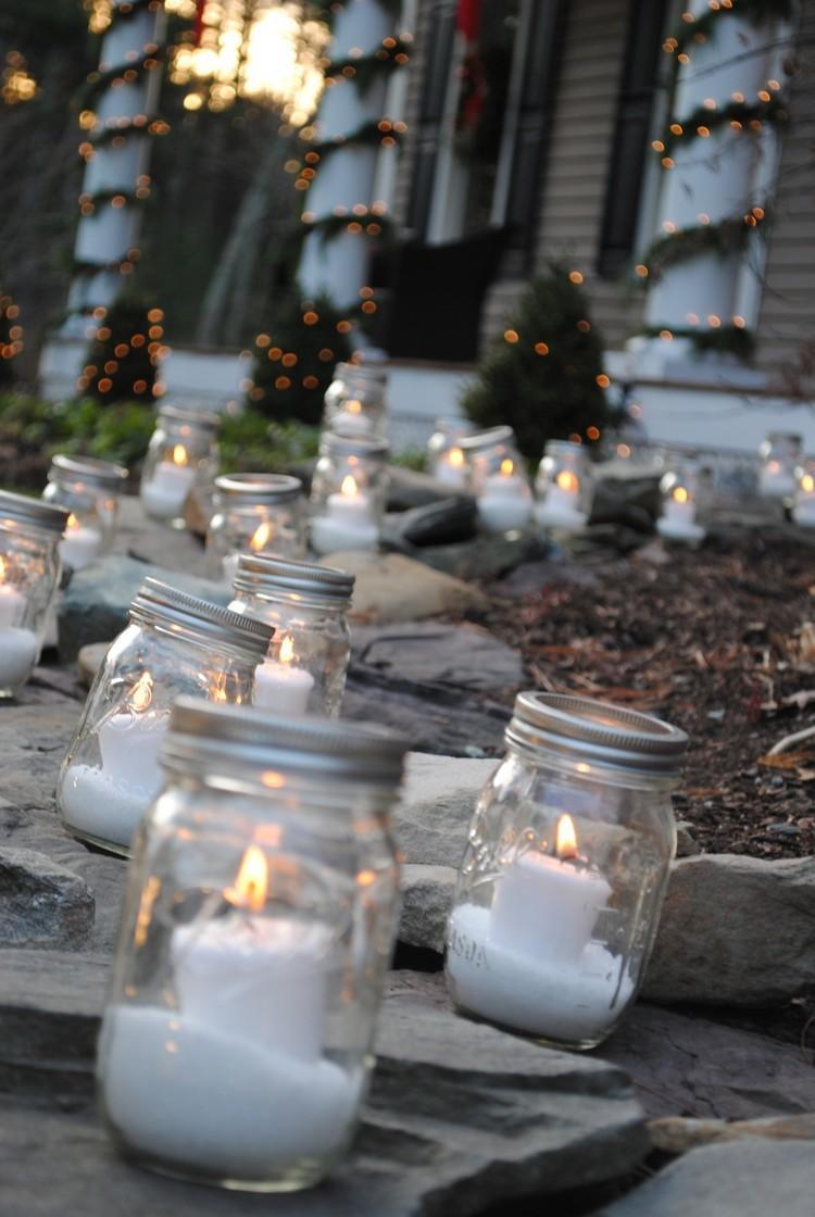 tarros de cristal decorativos velas ilumina jardin ideas