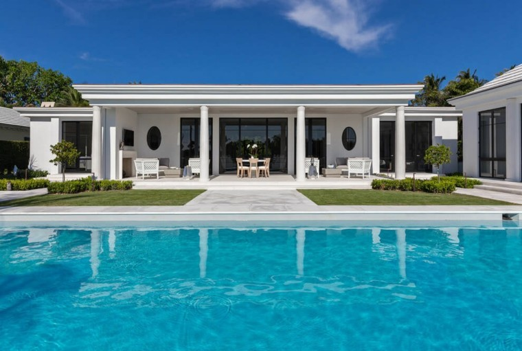 Oasis moderno 100 ideas para refugios en el jard n for Casa moderna con piscina
