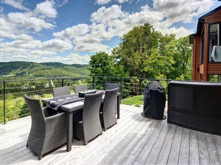 terraza elegante estilo patio ratan nubes