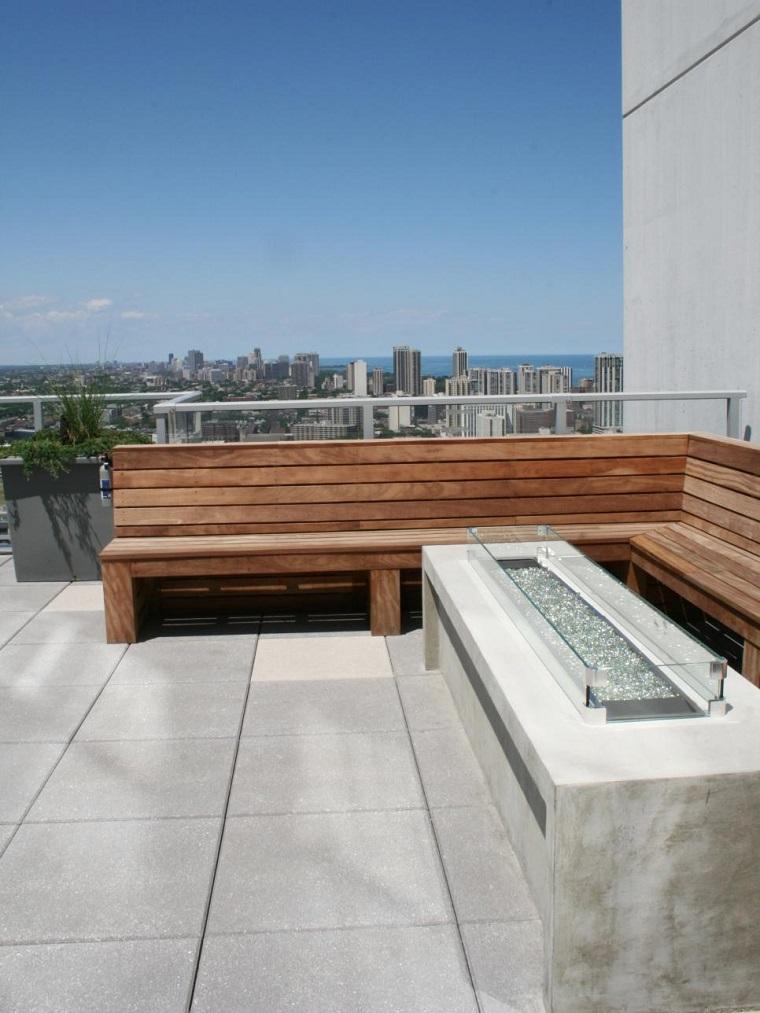terraza estilo minimalista lugar fuego banco madera suelo losas ideas