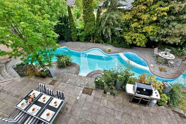 terraza mesa comidas barbacoa piscina forma original ideas