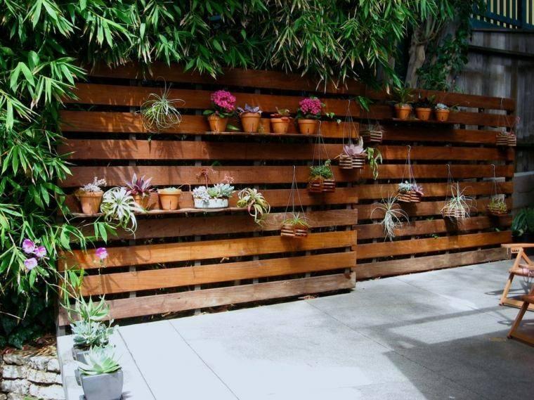 valla jardín macetas colgadas