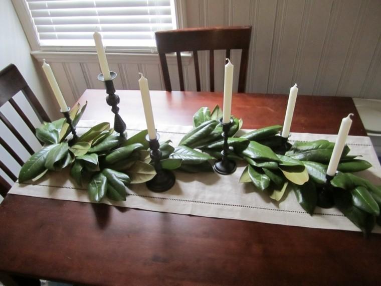 adornar mesa hojas magnolio velas
