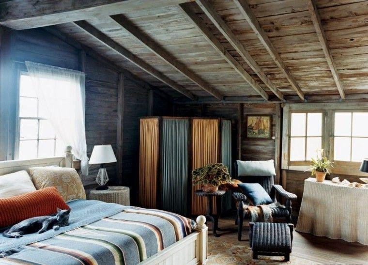cama cortinas lamparas cuadros azul