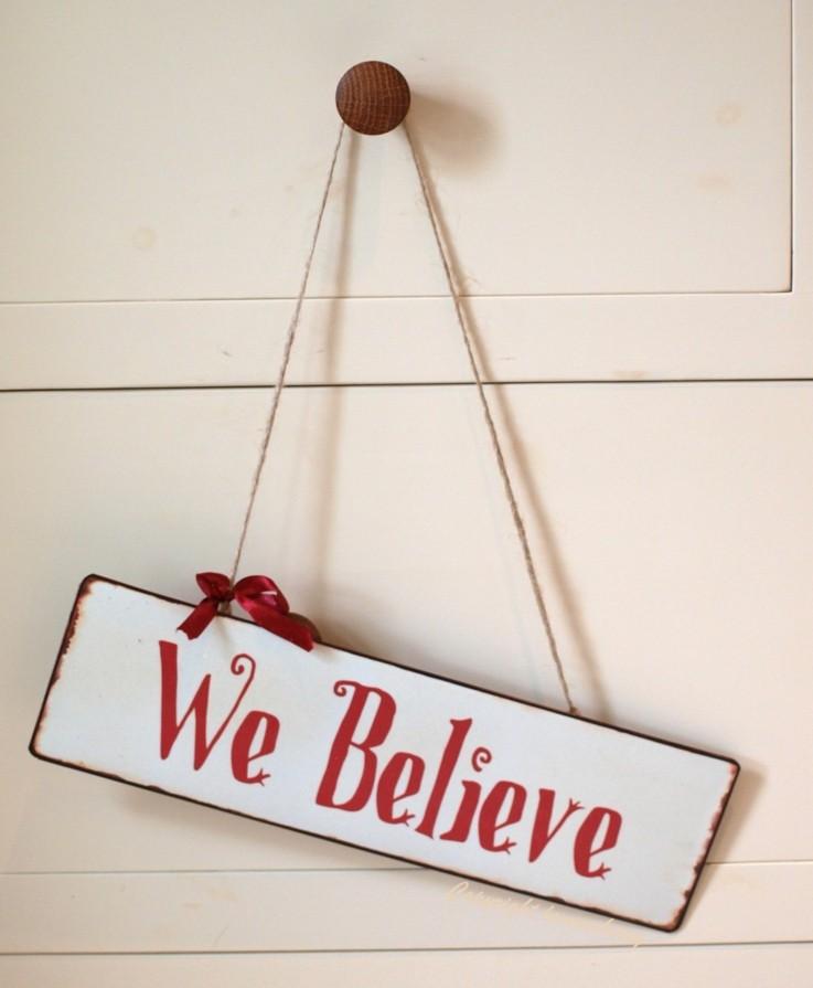 cartel navidad nosotros creemos lazo