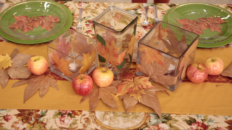 centros de mesa originales ideas manzanas hojas velas candelabros