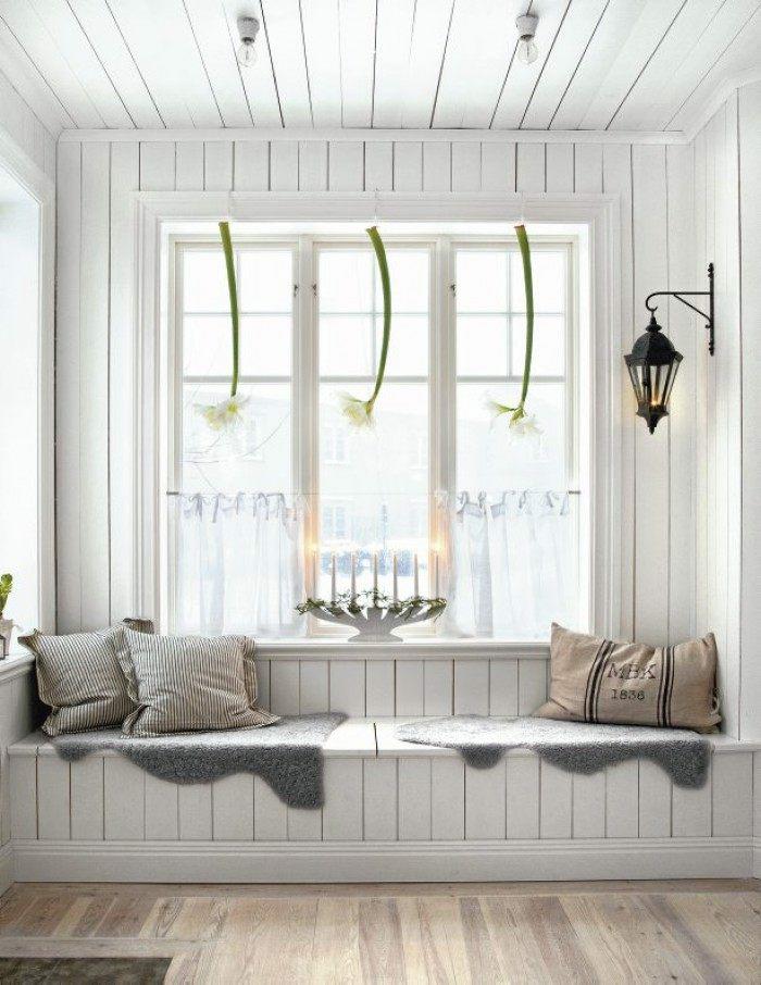decoracion nordica flores ventana cojines