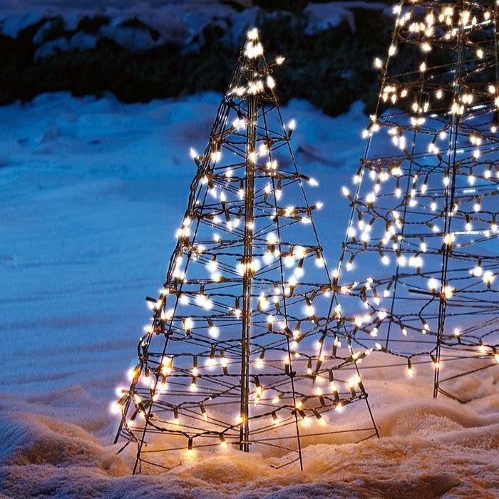 esqueletos abetos navidad luces blancas