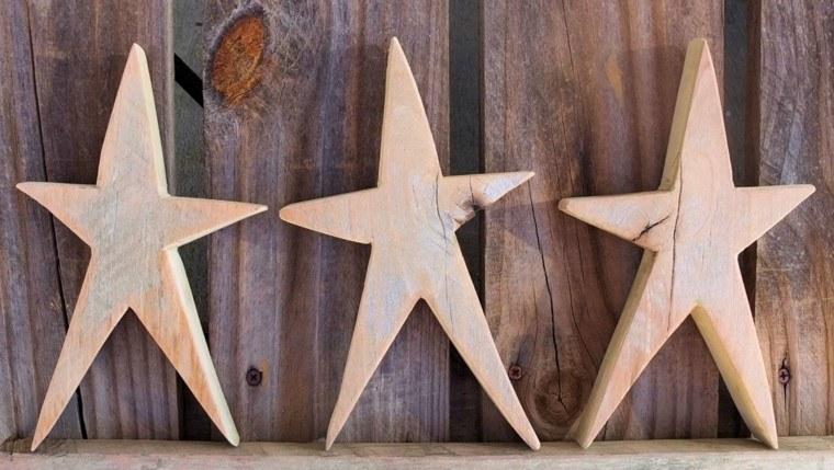 estrellas de navidad decorando casa madera ideas
