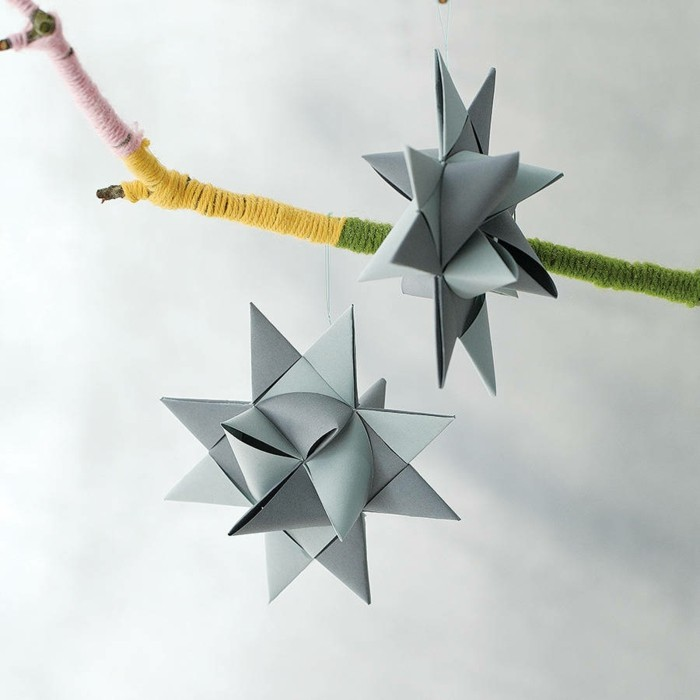 estrellas papel navidad gris