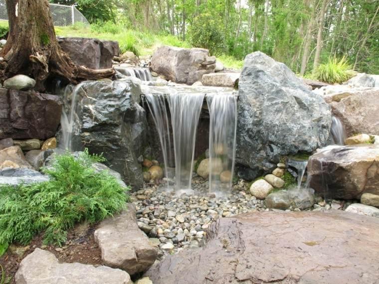 fuente cascada fondo bosque piedras