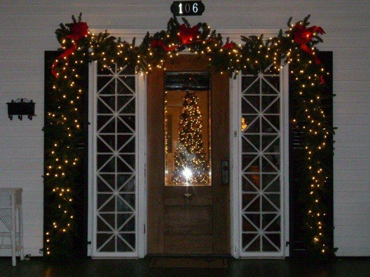 Guirnaldas de luces ramas papel flores para navidad for Decoracion de la puerta de entrada