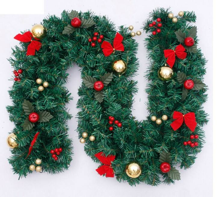 guirnalda navidad con lazos rojos