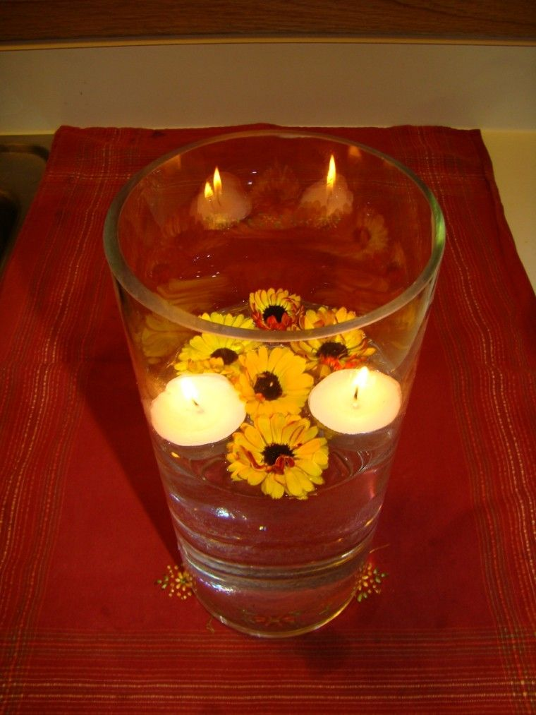 jarron cristal velas flores amarillas