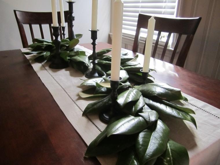 mesa decorada hojas velas