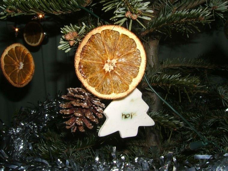 naranjas cortadas verde arboles luces