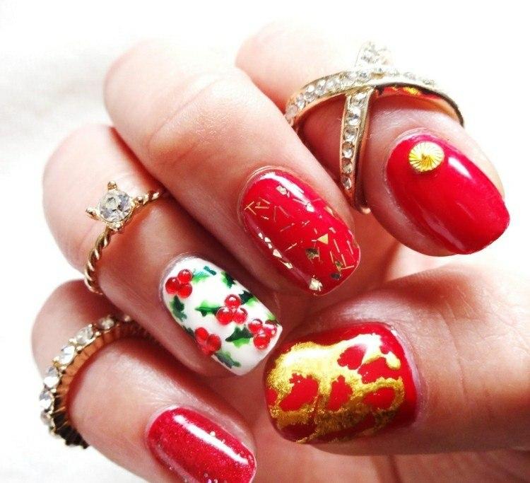 uñas decoradas tonos rojos adornos