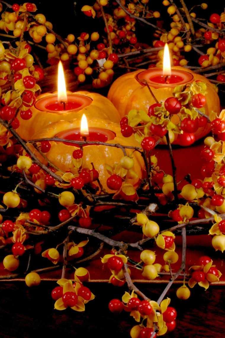 velas calabazas semilla rojas fuego