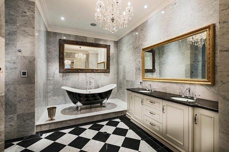 bañeras negras cuadros calido dorados