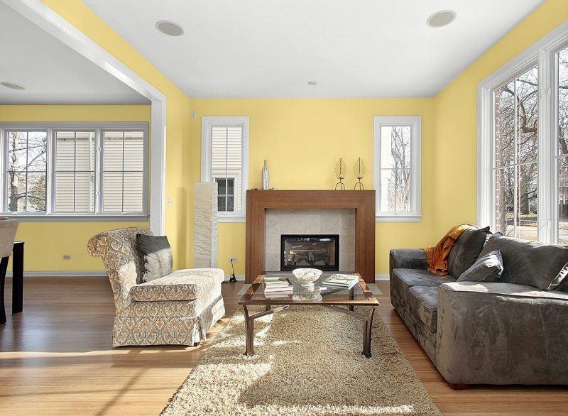 decorar pared colores salon amarillo vibrante ideas